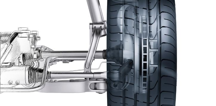side view of automotive suspension and wheel on a white background