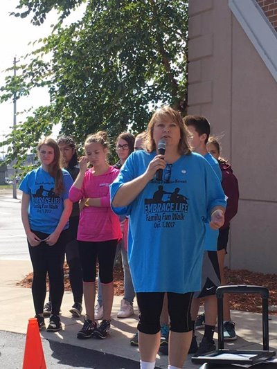 "Gail Schick speaks at the annual ""Embrace Life"" Family/Community Fun Walk"